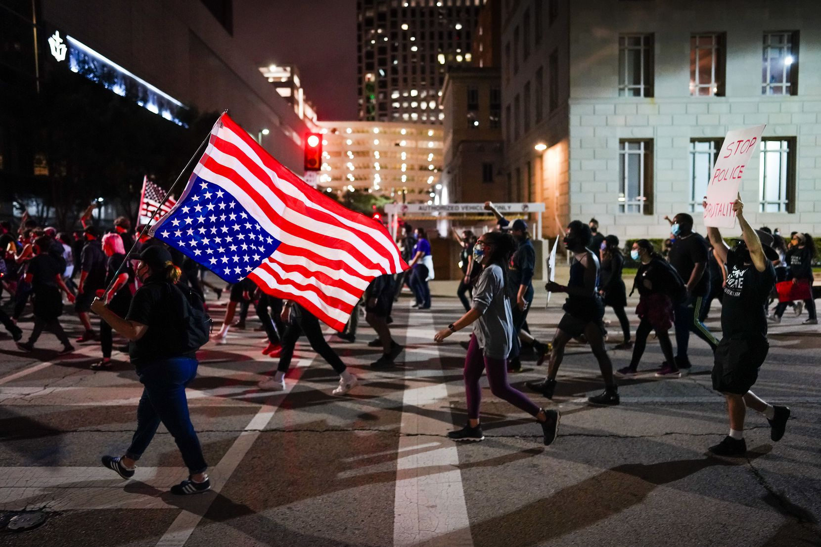 Demonstrators march on Ervay Street in downtown Dallas on Wednesday, Sept. 23, 2020. Protesters took to the streets around the country after a Kentucky grand jury brought no charges against Louisville police for the killing of Breonna Taylor.