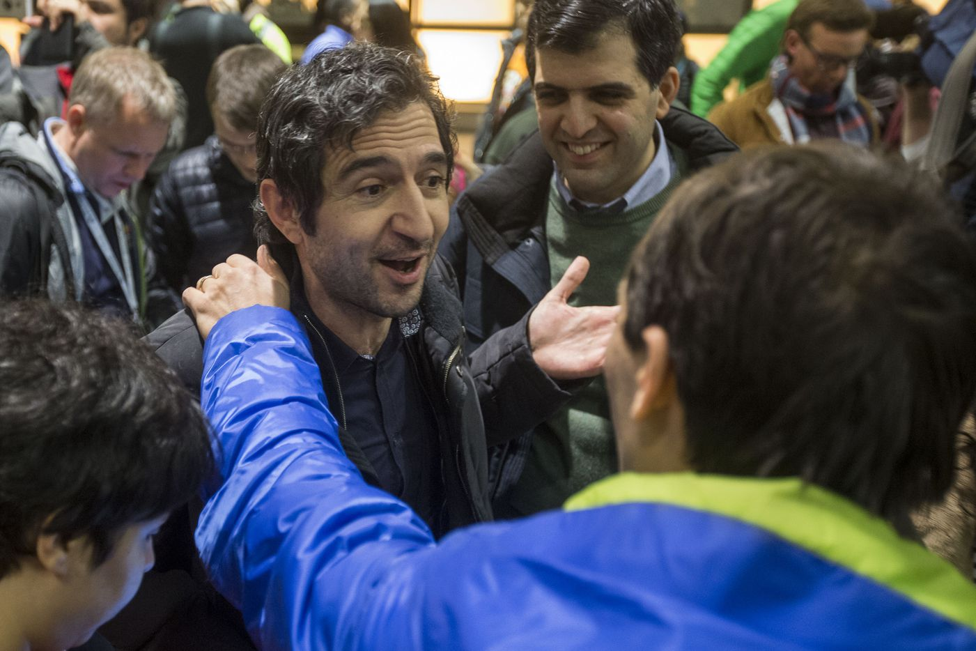 Mazdak Tootkaboni is welcomed during a demonstration against the new ban on immigration issued by President Donald Trump at Logan International Airport on January 28, 2017 in Boston, Massachusetts. Tootkaboni is a U.S. green card holder from Iran and a professor at the University of Massachusetts at Dartmouth, who was separated from other passengers and questioned as a result of the new immigration ban issued by President Donald Trump.