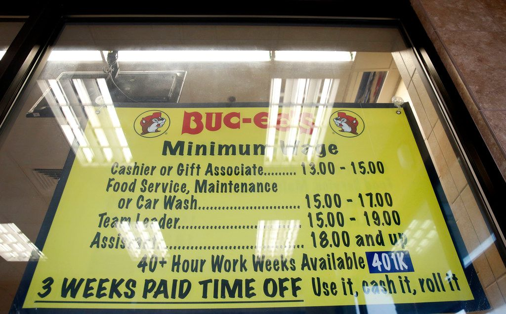 A sign shows the salary and benefits for employees at Buc-ee's in Madisonville, Texas on Wednesday, June 20, 2018. (Rose Baca/The Dallas Morning News)