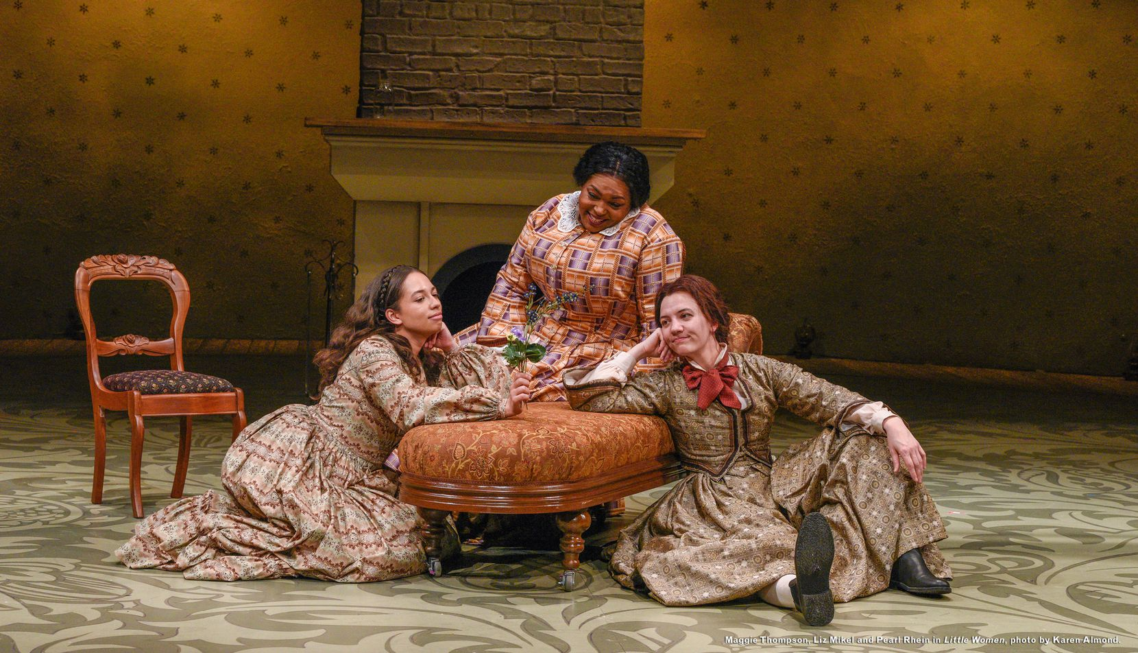 "Maggie Thompson (left), Liz Mikel and Pearl Rhein in a scene from ""Little Women,"" Dallas Theater Center's production of a new adaptation of the classic Louisa May Alcott novel by playwright Kate Hamill."