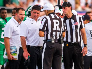 UNT head coach Seth Littrell talks to the officials during the first half of an NCAA football game against SMU at Ford Stadium on Saturday, Sept. 7, 2019, in Dallas. (Smiley N. Pool/The Dallas Morning News)