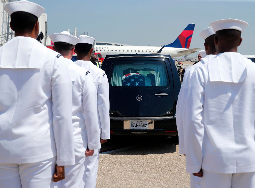 The remains of Navy Seaman 1st  Class (E3) George A. Coke Jr. of Arlington were carried from a commercial flight by members of the NAS JRB Navy Honor Guard to a waiting hearse at Dallas-Fort Worth International Airport, Friday, June 23, 2017. Coke, who perished in the USS Oklahoma after it sank at Pearl Harbor, was identified through recent DNA testing. The North Texas Patriot Guard Riders joined the procession to Moore Funeral Home in Arlington. A service for Coke will be held at First United Methodist Church in central Arlington Saturday before being buried at Parkdale Cemetery.
