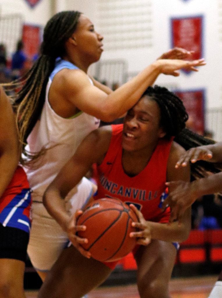 Duncanville's Anaya Bernaro (20) is fouled by Dallas Skyline's Francesca Jennings (24) while driving the lane during first half action. The two teams played their girls basketball game at  Skyline High School in Dallas on January 7, 2020. (Steve Hamm/ Special Contributor)