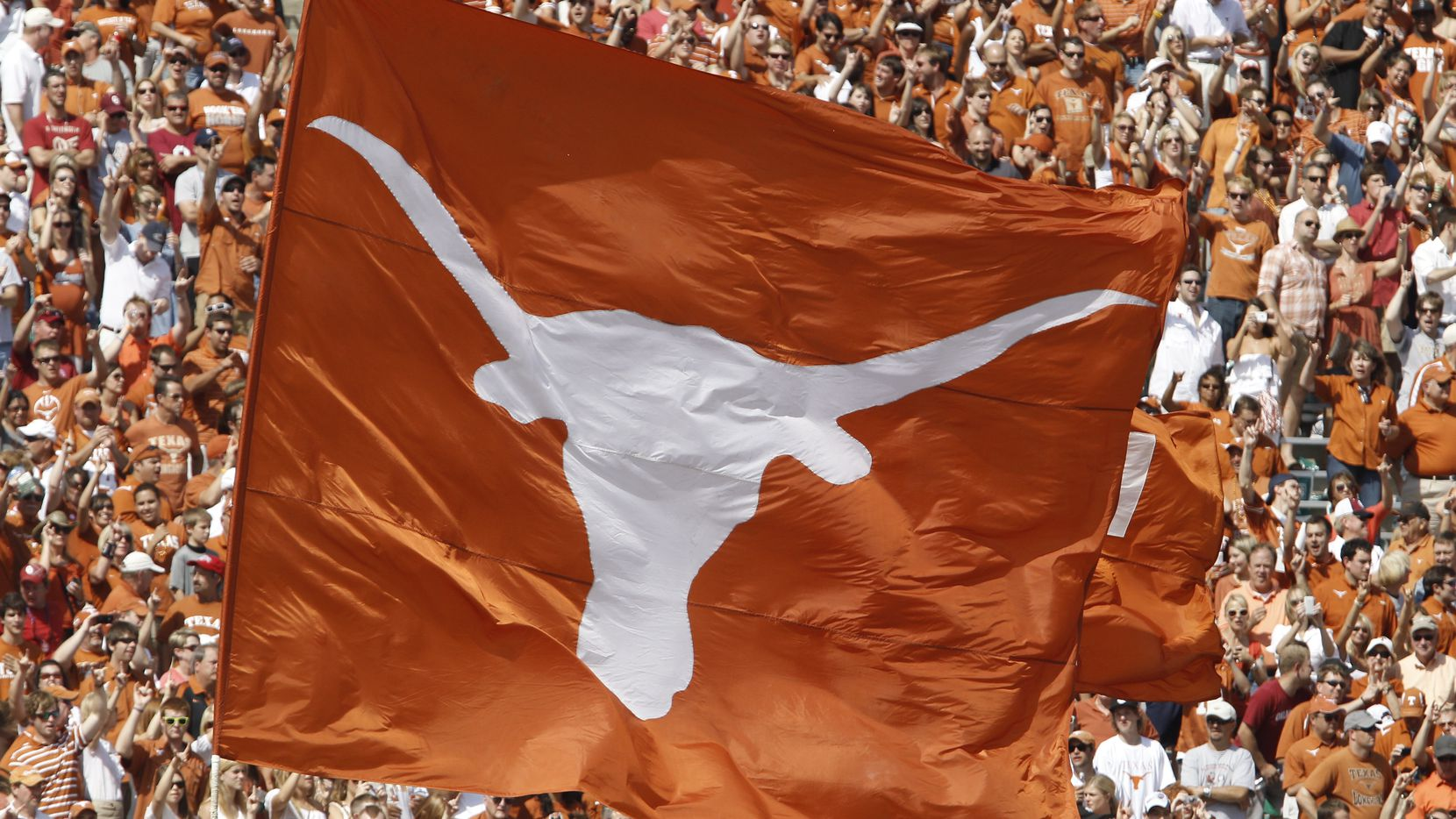 FILE - A Texas Longhorns flag is pictured during a game at the Cotton Bowl in Dallas on Saturday, Oct. 8, 2011.