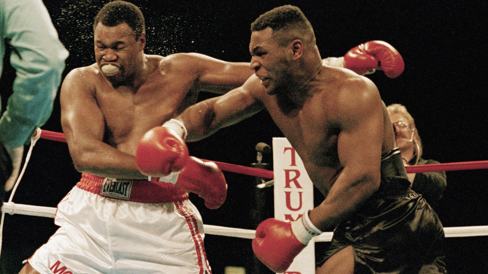 FILE - In this Jan. 22, 1988, file photo Larry Holmes bears brunt of a punch thrown by Mike Tyson during a heavyweight title boxing fight in Atlantic City, N.J. (AP Photo/File)