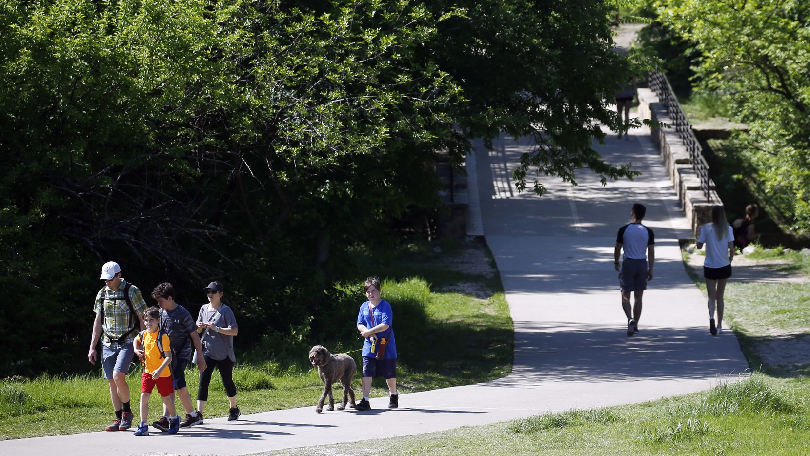 People make their way along the trail at Arbor Hills Nature Preserve, a 200 acre park in Plano.