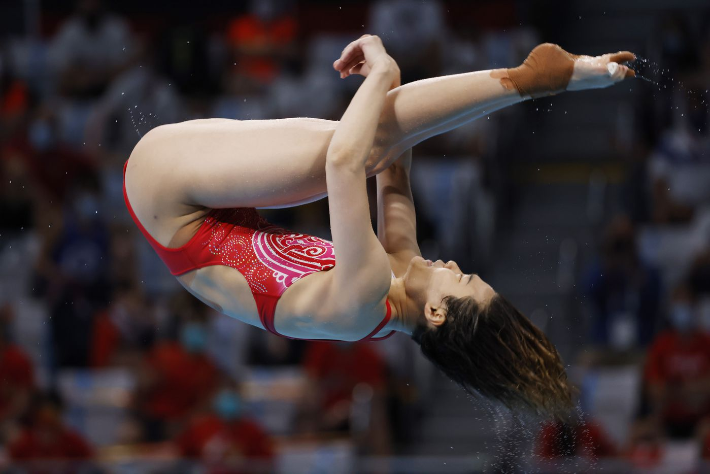 China's Shi Tingmao dives in the women's 3 meter springboard final during the postponed 2020 Tokyo Olympics at Tokyo Aquatics Centre, on Sunday, August 1, 2021, in Tokyo, Japan. Tingmao finished 1st with a total score of 383.50 to earn a gold medal. (Vernon Bryant/The Dallas Morning News)