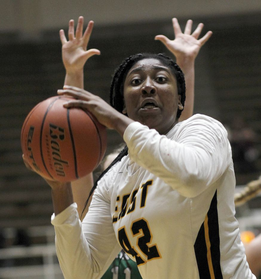 Plano East forward Idara Udo (42) reacts as she is trapped under the basket during first half action against Southlake Carroll. Plano East won 56-42 to advance. The two teams played their Class 6A regional semifinal girls playoff basketball game at Loos Field House in Addison on February 27, 2021. (Steve Hamm/ Special Contributor)