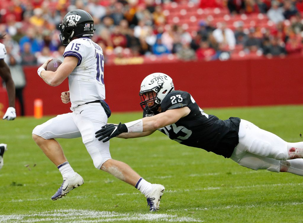 AMES, IA - OCTOBER 5: linebacker Mike Rose #23 of the Iowa State Cyclones tackles quarterback Max Duggan #15 of the TCU Horned Frogs as he rushed for yards in the first half of play at Jack Trice Stadium on October 5, 2019 in Ames, Iowa. (Photo by David Purdy/Getty Images)