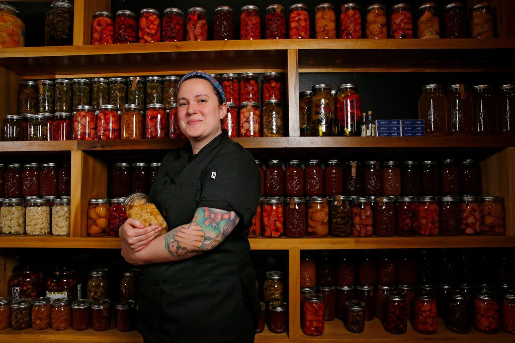 Executive chef Kendra Valentine, of Tapas Castile, worked with Jessica Kate-Martinez to jar and pickle hundreds of fruits and vegetables. The impressive display takes up an entire wall.