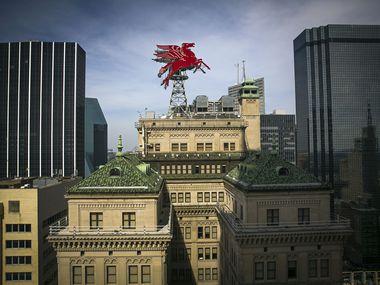 Dallas' landmark Magnolia Hotel Building has sold to a local hotel firm.