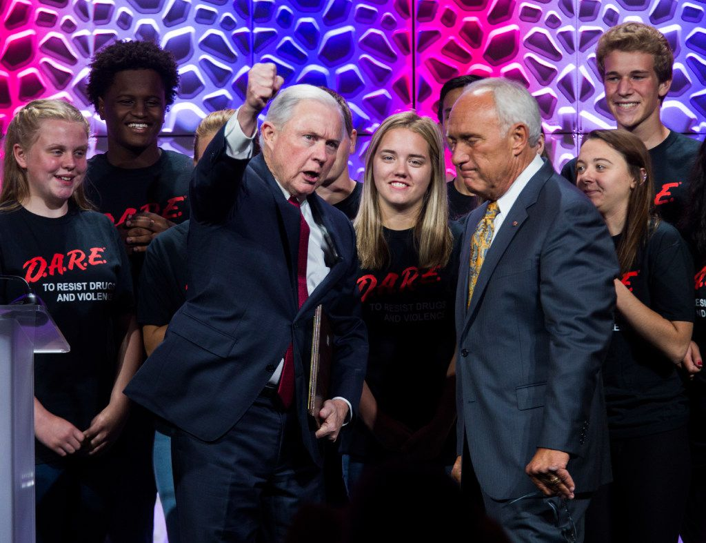 U.S. Attorney General Jeff Sessions pumps his fist as he is presented with a plaque from the DARE youth advocacy leaders after he spoke about the opioid epidemic at the 30th DARE International Training Conference on Tuesday, July 11, 2017 at the Gaylord Texan in Grapevine, Texas. (Ashley Landis/The Dallas Morning News)