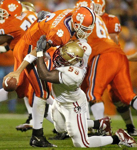 ORG XMIT: *S0407260824* KRT SPORTS STORY SLUGGED: FLSTATE-CLEMSON KRT PHOTOGRAPH BY PHIL SEARS/TALLAHASSEE DEMOCRAT (November 8) TALLAHASSEE, FL -- Clemson quarterback Charlie Whitehurst (6) is sacked by Florida State University's defensive tackly Charles Howard (59) for a loss of 11 yards in the first half of their game in Tallahassee, Florida, on Saturday, November 8, 2003. (nk) 2003 11092003xSPORTS2