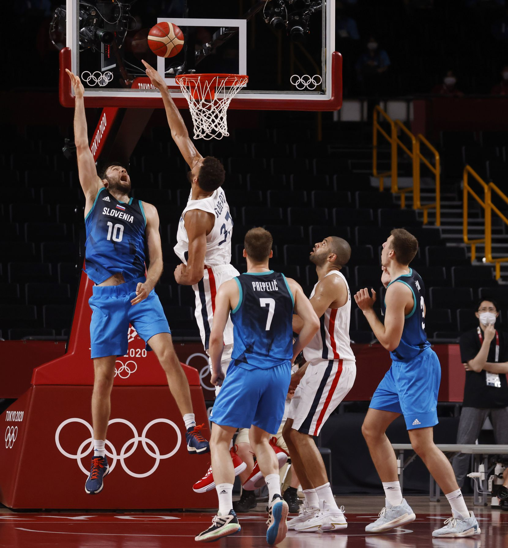 Slovenia's Mike Tobey (10) makes a shot over the arms of France's Rudy Gobert (27) during the second half of a men's basketball semifinal at the postponed 2020 Tokyo Olympics at Saitama Super Arena, on Thursday, August 5, 2021, in Saitama, Japan. France defeated Slovenia 90-89. Slovenia will play in the bronze medal game. (Vernon Bryant/The Dallas Morning News)