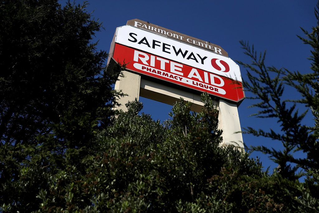 PACIFICA, CA - FEBRUARY 20:  A sign for Safeway and Rite Aid is posted in front of the Fairmont Center on February 20, 2018 in Pacifica, California. Grocery chain Albertsons, a subsidiarie of Safeway Inc., announced that it will acquire Rite Aid in a cash and stock deal  (Photo by Justin Sullivan/Getty Images)