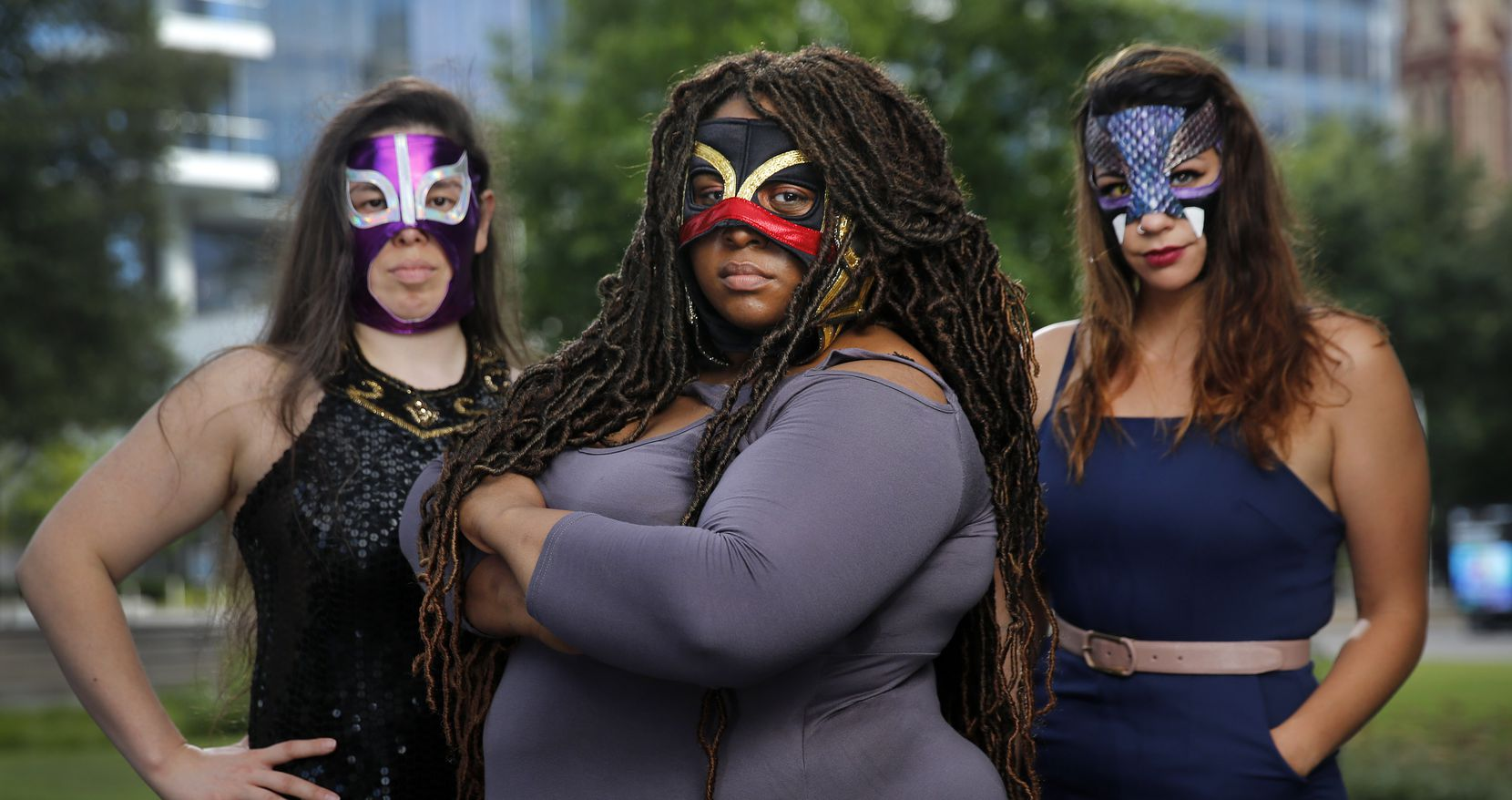 """Tiffany Lang, center, was cast as Coyol in Prism Movement Theater's """"Lucha Teotl,"""" a new play that takes the form of a Mexican lucha libre pro-wrestling storyline, but later left the production. Lang poses in the Dallas Arts District with Jennifer Ramirez and Tatiana Lucia Gantt, who also portray masked luchadores."""