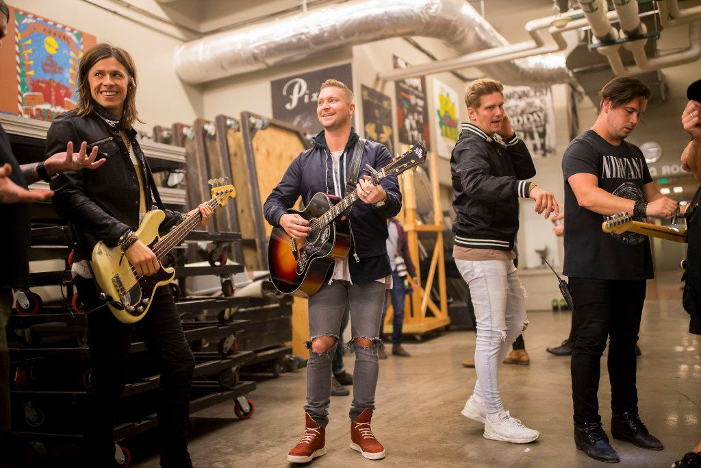 NEEDTOBREATHE members Seth Bolt (left), Bear Rinehart (center), and Bo Rinehart (second to right) in the back stage before the concert during Tour De Compadres at Verizon Theater on Oct. 22, 2016 in Grand Prairie, Texas. (Ting Shen/The Dallas Morning News)