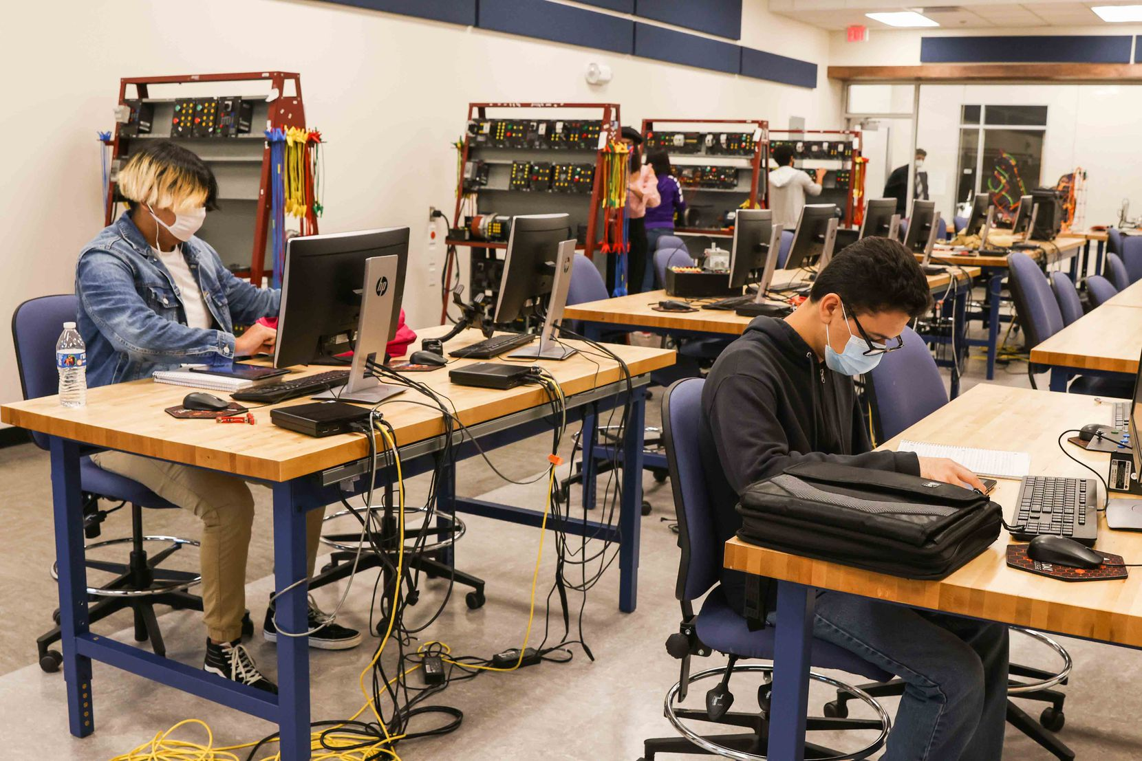 Spruce Early College High School students during a class to get and associate degree in advanced manufacturing and mechatronics technology at Eastfield College Campus in Mesquite on Thursday, April 29, 2021. (Lola Gomez/The Dallas Morning News)