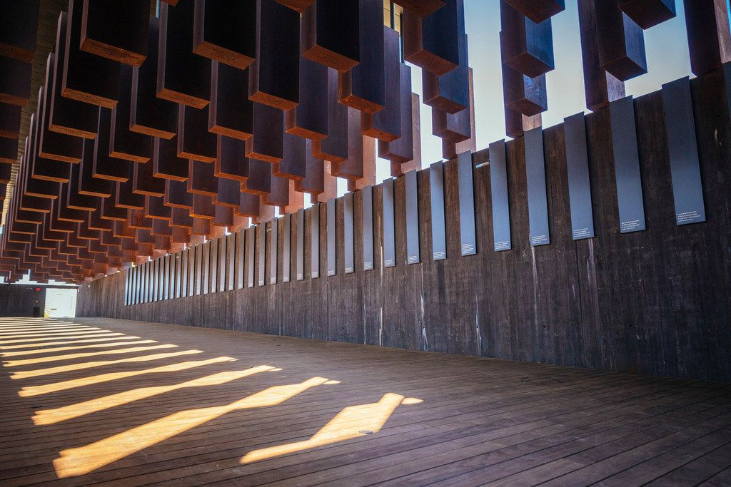 Eight hundred weathered steel columns, each one etched with the name of a lynching victim, hang from the roof of the new National Memorial for Peace and Justice in Montgomery, Ala.