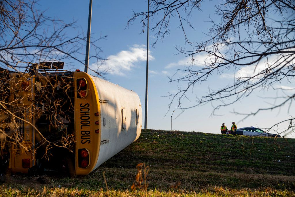 A school bus from Bishop Dunne Catholic School overturned in the westbound lanes of I-30 near Loop 12 in Dallas on Thursday, Jan. 17, 2019. Multiple people on board the bus were been taken to nearby hospitals after the crash.