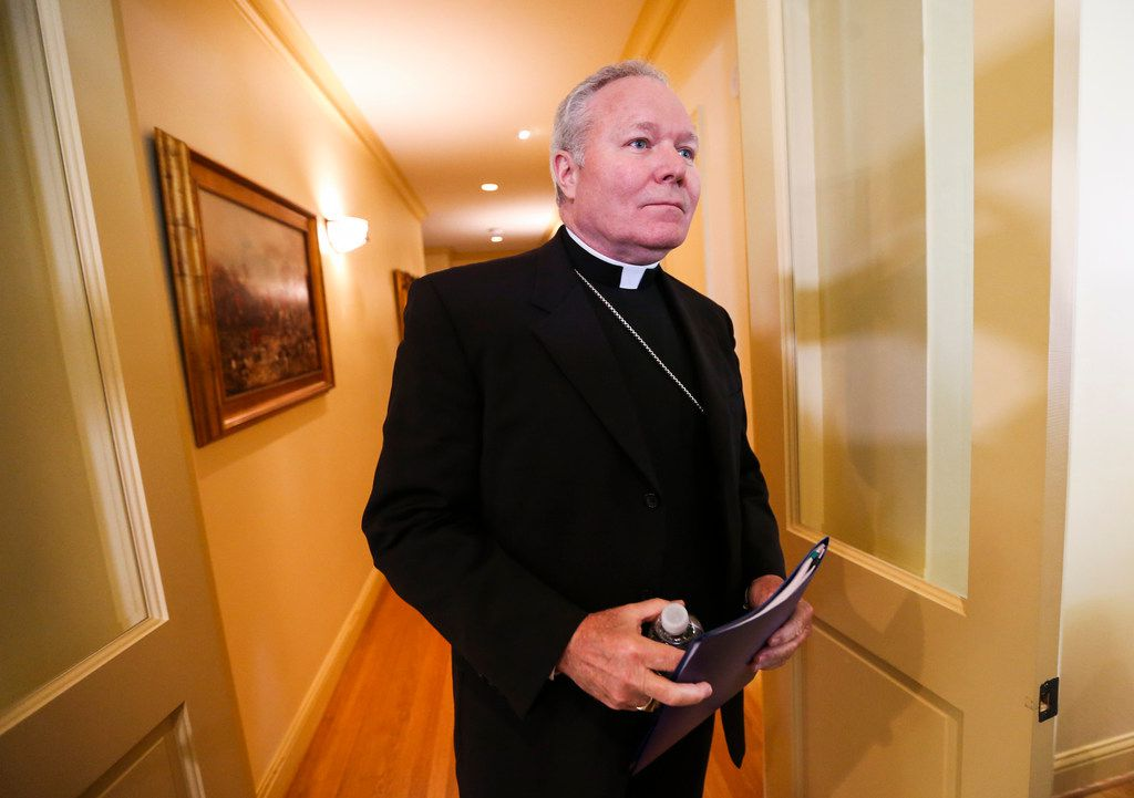 In a file photo, Dallas Bishop Edward J. Burns enters a room at Holy Trinity Catholic Church to speak to members of the media after a police raid on several of the diocese's offices May 15, 2019.