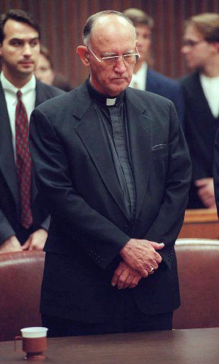 The Rev. Charles Grahmann stood in court in July 1997 after the Catholic Church was found negligent in a case alleging molestation of boys by a priest.  In the largest verdict of its kind, the Roman Catholic Diocese of Dallas was ordered to pay nearly $120 million for allowing priest Rudy Kos to molest altar boys and then conspiring to cover it up.