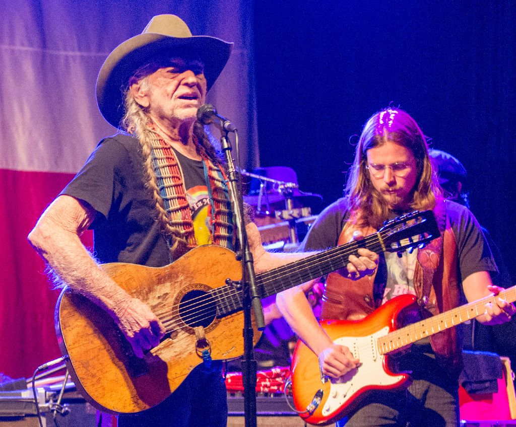 Country music legend Willie Nelson performs at Billy Bob's Texas on November 12, 2016 during the bar's 35th anniversary celebration in Fort Worth.. Nelson's son, Lukas Nelson, is at right.