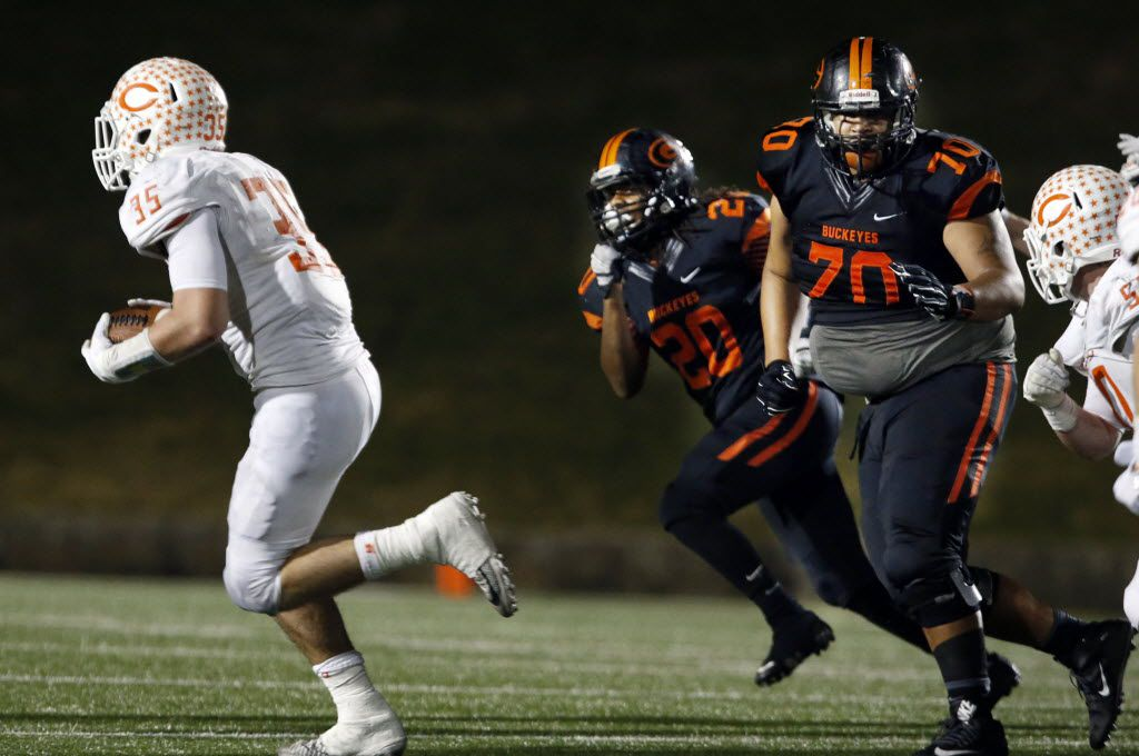 (TXHSFB) Celina High's Shane Gerths (35) returns an interception for a touchdown, as Gilmer's Cambron Granville (20) and Lucas Garrett (70) chase him in the final minutes of the Bobcat's 44-49 win in a high school football playoff game on Friday, December 11, 2014. (John F. Rhodes / Special Contributor)