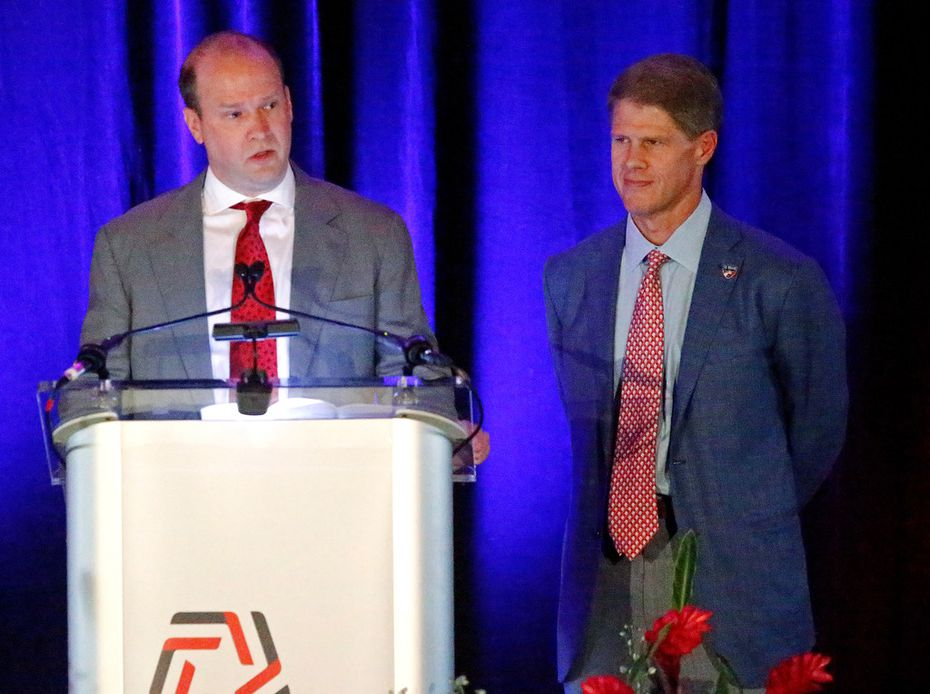 Dan Hunt (left) speaks from the podium while his brother Clark Hunt looks on during the induction ceremony for the 2019 U.S. Soccer Hall of Fame at Toyota Stadium in Frisco on Saturday, September 21, 2019. (Stewart F. House/Special Contributor)