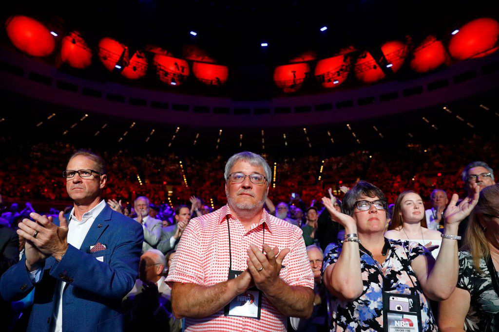 NRA supporters applaud President Donald Trump speaks to the crowd assembled in the Kay Bailey Hutchison Convention Center for the NRA Annual Meeting in Dallas, Friday, May 4, 2018. . This is the second year as President that Trump has spoken to the gun rights group.