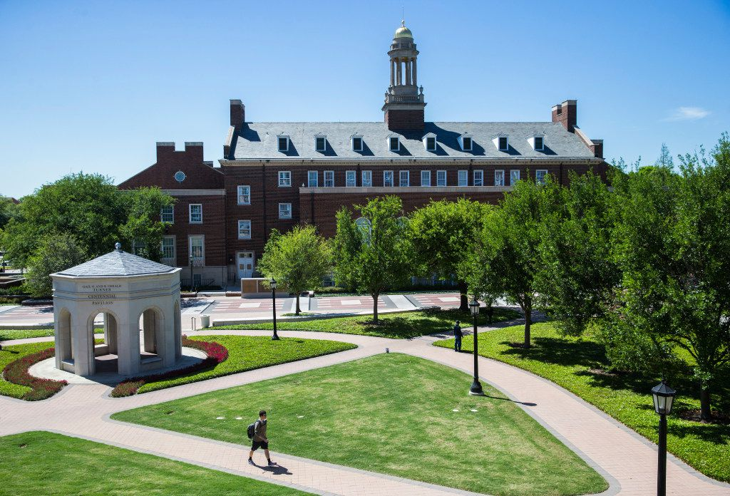 A student walks past the Joseph Wiley Fincher Building at the Cox School of Business at Southern Methodist University.