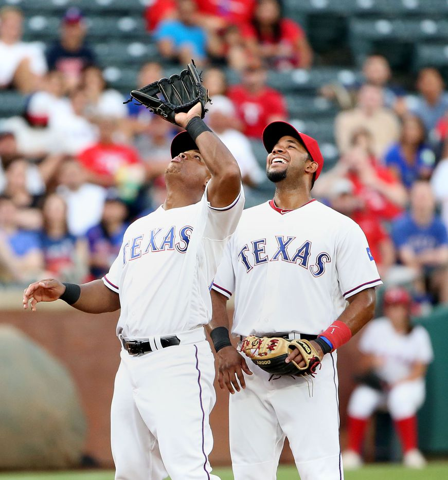 Texas Rangers shortstop Elvis Andrus (1) looks on as third baseman Adrian Beltre (29) catches a pop fly by Oakland Athletics third baseman Danny Valencia in the third inning during a Major League Baseball game between the Oakland Athletics and the Texas Rangers at Globe Life Park in Arlington, Texas Monday August 15, 2016. (Andy Jacobsohn/The Dallas Morning News)
