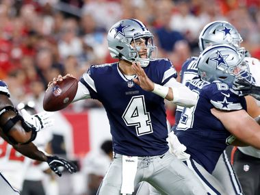 Dallas Cowboys quarterback Dak Prescott (4) throws from the pocket in the first quarter against the Tampa Bay Buccaneers at Raymond James Stadium in Tampa, Florida, Thursday, September 9, 2021.