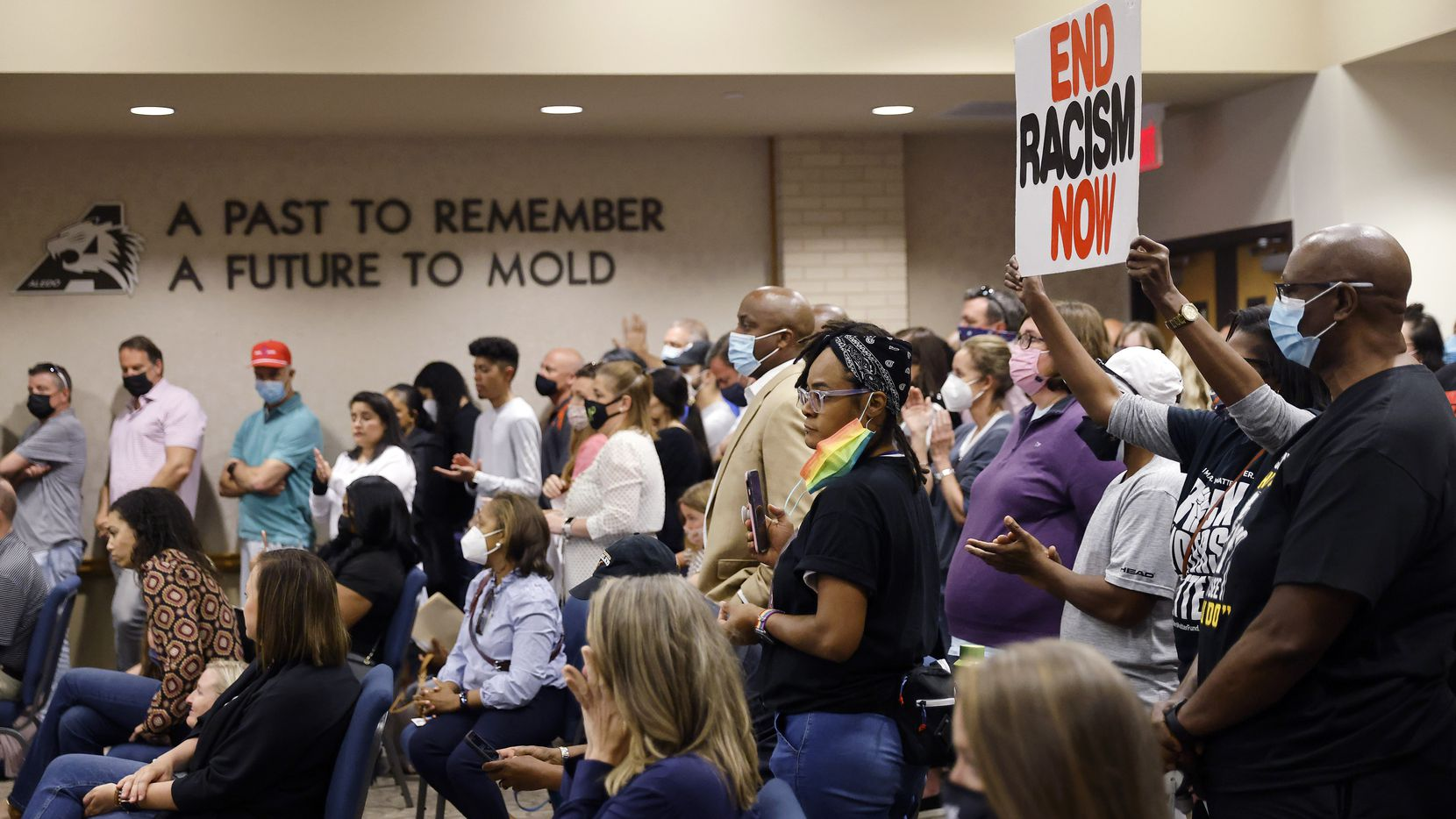 """Parents and supporters gathered in the Aledo ISD school board chamber to voice their concerns about a racist Snapchat group with multiple names, including """"Slave Trade"""" and another that included a racial slur, April 19, 2021. Mioshi Johnson's son, Christopher Johnson, spoke to the school board himself after being targeted in the social media post by students."""