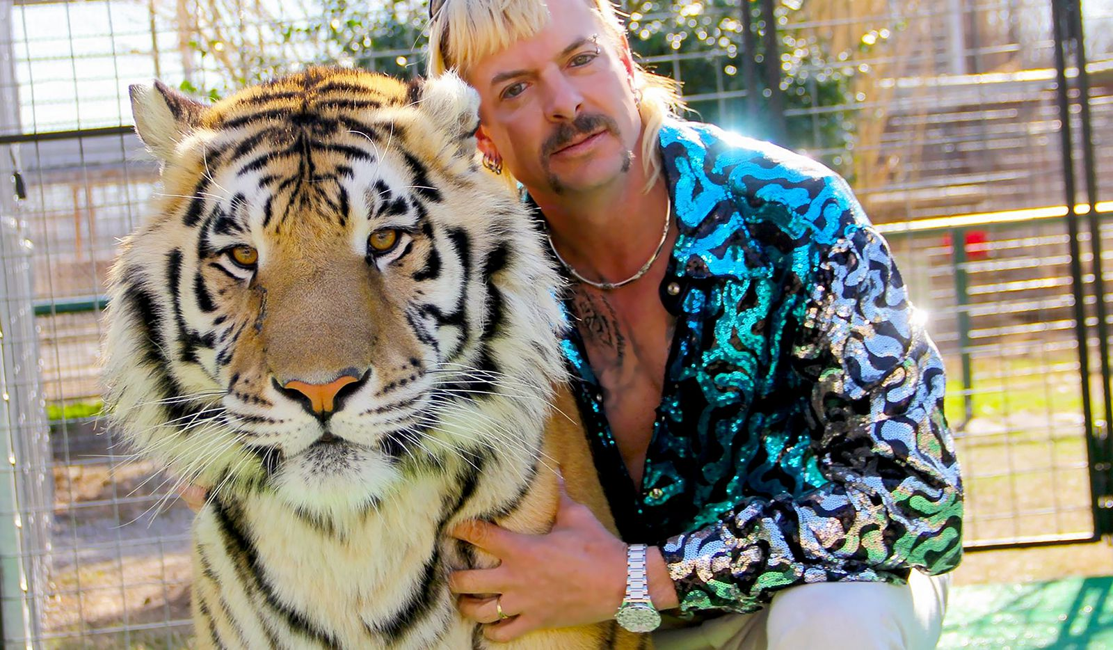 """Joe Exotic with one of his many, many tigers in """"Tiger King."""""""