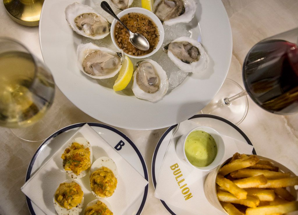Our ideal order at Bullion's happy hour: oysters with Champagne mignonette, pommes frites with tarragon dijonnaise, deviled eggs with smoked ocean trout and two glasses of wine.