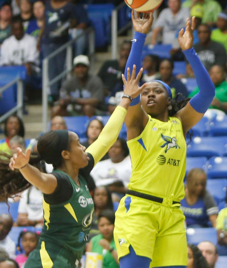 Dallas Wings guard Arike Ogunbowale (24) shoots over the defense of Seattle Storm guard Jordin Canada ((21) during first half action. The two teams played their WNBA game at College Park Center in Arlington on September 8, 2019. (Steve Hamm/ Special Contributor)