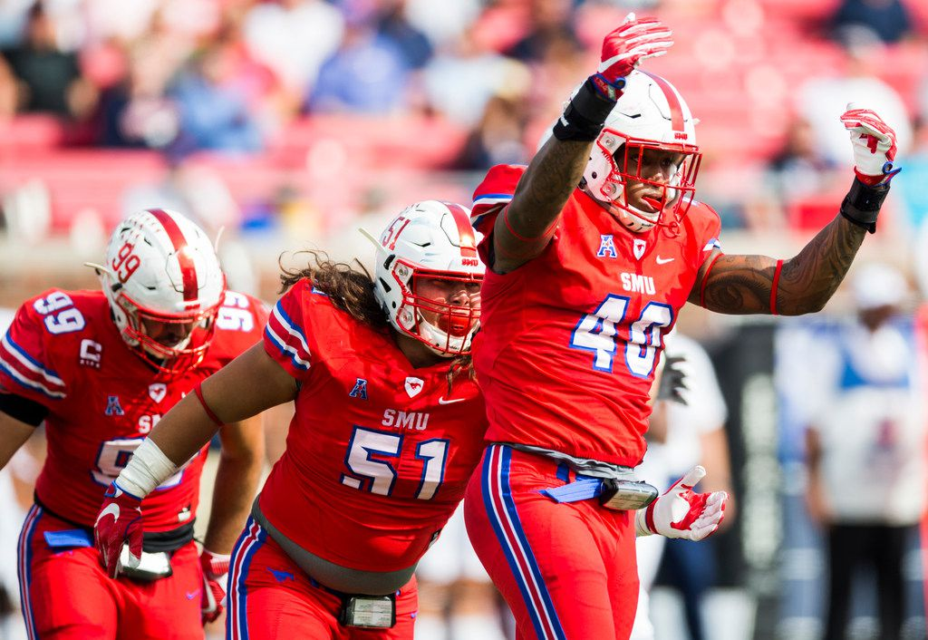 Southern Methodist Mustangs defensive lineman Dimarya Mixon (40) celebrates with defensive tackle Pono Davis (51) after a sack during the first quarter of a football game between the University of Connecticut and SMU Texas on Saturday, September 30, 2017 at SMU's Ford Stadium in Dallas. (Ashley Landis/The Dallas Morning News)