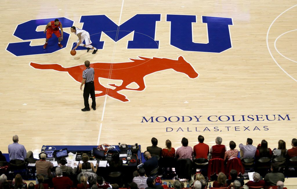 SMU guard Nick Russell (12) defends against Shabazz Napier (13) during SMU vs. Connecticut basketball game on January 4, 2014 at Moody Coliseum in Dallas.