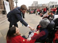 Rep. Matt Krause, R-Tarrant County (left) visits with Beckham Sheiman, 3, and her mother Maegan Sheiman during a rally hosted by Protect Fragile TX Children outside the Texas State Capitol,.