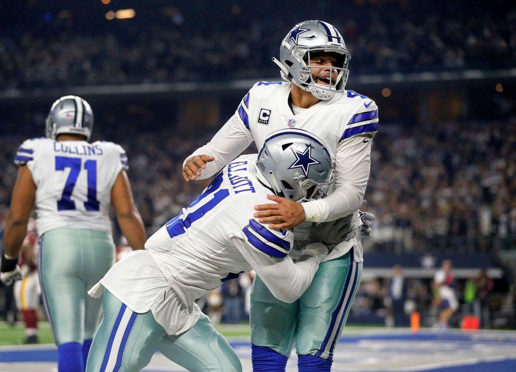 FILE - Cowboys quarterback Dak Prescott (4) celebrates with running back Ezekiel Elliott (21) after a fourth-quarter touchdown against the Redskins at AT&T Stadium in Arlington on Thursday, Nov. 22, 2018. (Tom Fox/The Dallas Morning News)