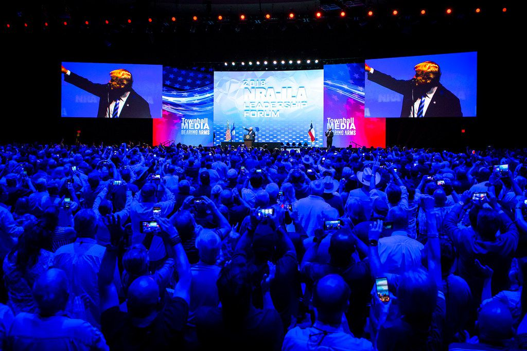 People in the crowd trained their phones on President Donald Trump as he spoke at the NRA's annual convention Friday in Dallas.