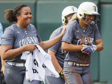 The Colony's Jayda Coleman (10, right) celebrates a run with pitcher Karlie Charles (29) during the first inning of a UIL Class 5A state semifinal softball game between The Colony and Corpus Christi Calallen on Friday, May 31, 2019 at Red & Charline McCombs Field at the University of Texas in Austin.