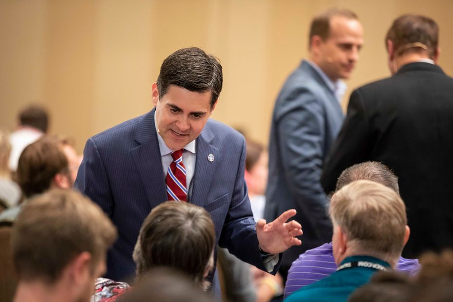 Russell Moore talks with people in the audience before a panel at the Southern Baptist Convention annual meeting at the Omni Hotel on Monday, June 11, 2018, in Dallas.