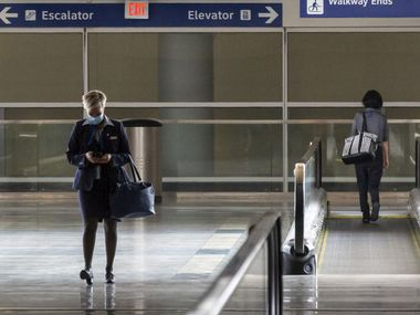 An American Airlines employee walked out of Terminal D at DFW International Airport on July 26.
