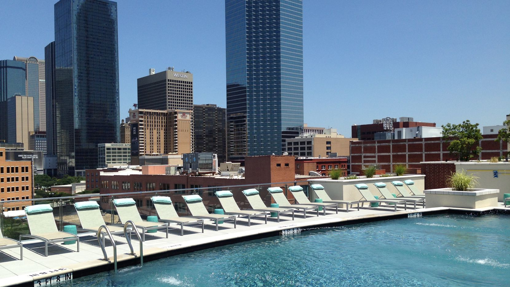 Rooftop pools with skyline views are standard for the newest Dallas apartment projects.