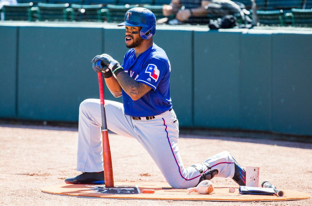 Texas Rangers center fielder Delino DeShields (3) stretches before batting during the first inning of a spring training game against he Oakland Athletics on Thursday, March 2, 2017 at Hohokam Stadium in Mesa, Arizona. (Ashley Landis/The Dallas Morning News)