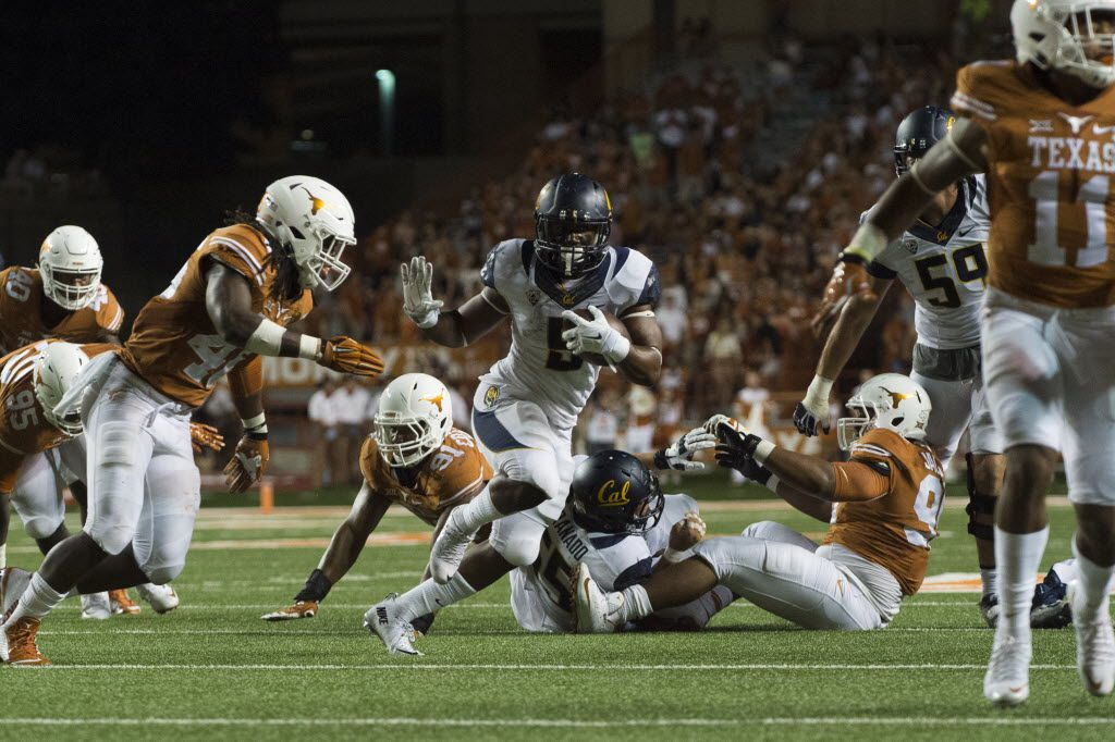 FILE - California's Tre Watson (5) breaks free against Texas during the third quarter of a game on Sept. 19, 2015, at Darrell K Royal-Texas Memorial Stadium in Austin.  (Photo by Cooper Neill/Getty Images)
