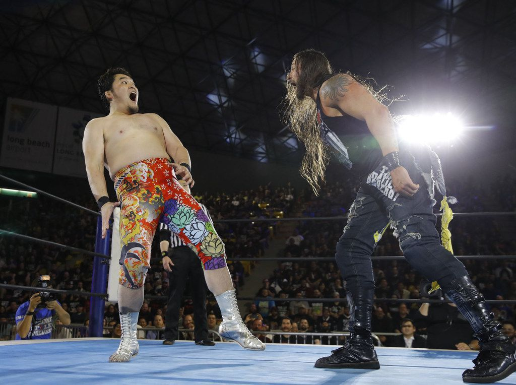 "Professional wrestler Lance Hoyt — who goes professionally by the name ""The American Psycho"" Lance Archer — of Cedar Hill, Texas (right) a professional wrestler known as ""The American Psycho"" in Japan's version of WWE, faces off against Toru Yano (left) in March 2018. (Courtesy of AXS TV/NJPW)"
