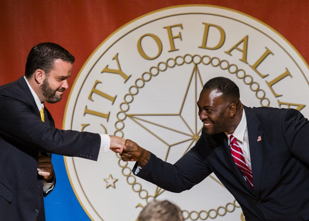 City Council members Adam McGough, left, and Casey Thomas  share a congratulatory fist bump after being sworn in a year ago. They are among a strong class of freshmen representatives.